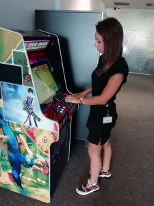 TNation employee playing an arcade game